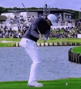 Rory McIlroy on the downswing with right elbow tucked to his side. golf downswing start the downswing right downswing