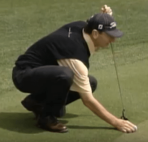 Brad Faxon aligns his line on the intended line of the putt Improve Your Putting Aim by Aligning Your Ball's Line