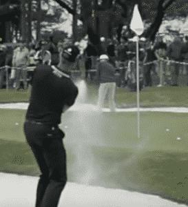 Henrik Stenson puts sand on the green out of the greenside bunker golf bunker shot golf sand shot bunker golf