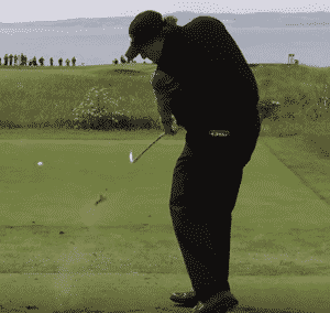 Phil Mickelson hitting down on an iron shot off the tee