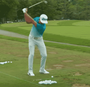 Rickie Fowler warming up for a round range balls alignment stick golf warm up golf warm up routine